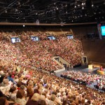 Mormon women sing in Marriott Center at BYU Women's Conference