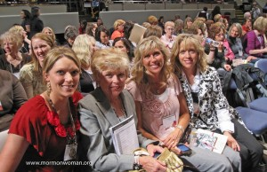 Mormon women pose for a photo between BYU Women's Conference sessions
