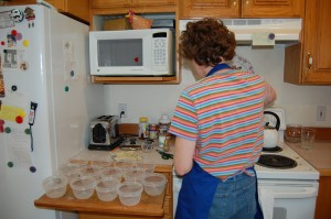 LDS woman works in her kitchen to make freezer jam