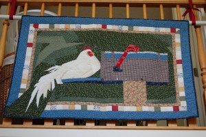 LDS woman quilt hanging in home