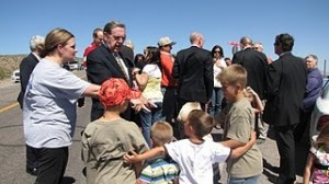 LDS apostle with children